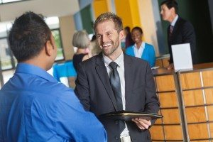 Prospective-employer-discussing-company-with-businessman-at-job-fair-000021418712_Full