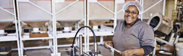 Portrait of a smiling woman at work in a distribution warehouse